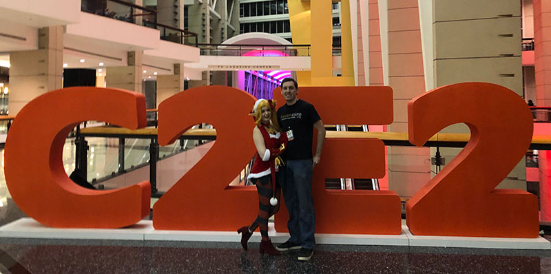 My wife and I with the C2E2 sign